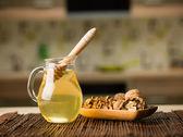 Honey and wallnuts on kitchen table — Stock Photo