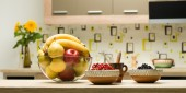 Healthy fruits on kitchen countertop — Stock Photo