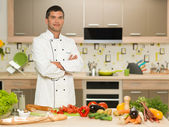 Confident chef standing in kitchen — Stock Photo