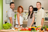 Friends posing while cooking — Stock Photo
