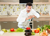 Angry chef cutting vegetables — Stock Photo