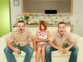 Friends at home watching tv — Stock Photo