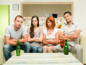 Upset friends watching tv — Stock Photo