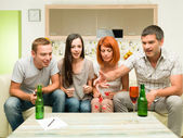 Friends playing game with dices — Stock Photo