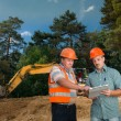 Engineers discussing on construction site — Stock Photo #54885067