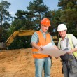 Colleagues on construction site — Stock Photo