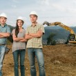 Team of architects on construction site — Stock Photo #54885635
