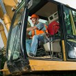 Male worker operating excavator — Stock Photo #54885919