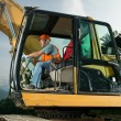 Male worker operating excavator — Stock Photo #54885921