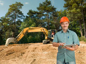 Engineer with digital tablet on construction site — Stock fotografie
