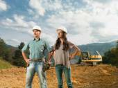 Young engineers supervising construction — Stock Photo