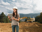 Female architect supervising construction — Stock Photo