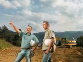 Engineers supervising construction in progress — Stock Photo