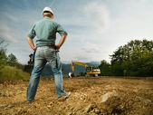 Engineer evaluating construction progress — Stock Photo