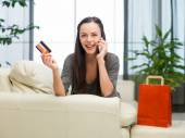 Happy woman shopping on the phone — Stock Photo