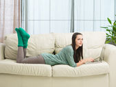 Teenage girl relaxing at home — Stock Photo