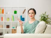 Beautiful female artist at home — Stock Photo