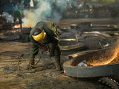 Welder on recycling site — Stock Photo