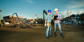 Engineers having a discussion in scrapyard — Stock Photo