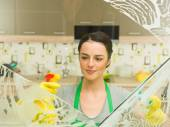 Happy housewife doing chores — Stock Photo