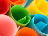 Colorful rolled up paper — Stock Photo