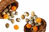 Isolated quail eggs in a basket with decorative wooden balls — Stock Photo