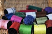 Skeins needle and colored threads — Stock Photo