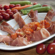 Постер, плакат: Appetizer at the raw ham and tomatoes
