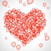 Red balloons make heart shape — Stock Photo