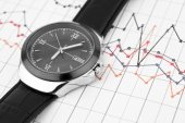 Wrist watch on chart. — Stock Photo