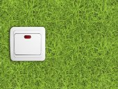 Light switch over green grass — Stockfoto