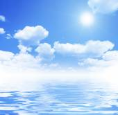 Blue sky, white clouds and water — Stock Photo