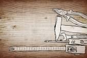 Hulpprogramma's op een houten achtergrond — Stockfoto