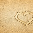 Heart drawing in sand — Stock Photo #68937915