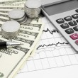 Pen,calculator and dollars on chart — Stock Photo #69689563