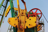 Golden yellow Oil pump of crude oilwell rig — Stock Photo