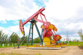 Pink Oil pump of crude oilwell rig — Stock Photo