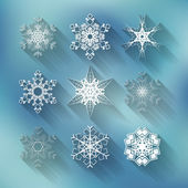 Set of nine vector different snowflakes on blue background — Stock Vector
