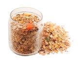 delicious healthy muesli in jar over white — Стоковое фото
