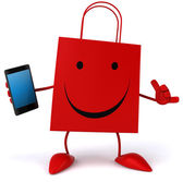 Shopping bag with smart phone — Stock Photo