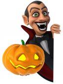 Fun vampire with pumpkin — Stock Photo