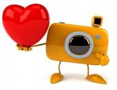 Camera with heart — Stock Photo