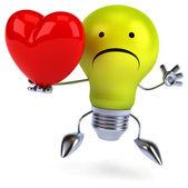 Light bulb with heart — Stock Photo