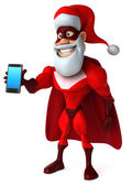 Santa Clause in superhero costume with smart phone — Stock Photo