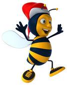 Fun bee in Santa's hat — Stock Photo
