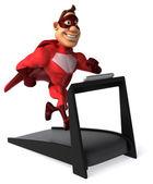 Fun superhero on treadmill — Stock Photo