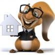 Fun squirrel with house model — Stock Photo #59327789
