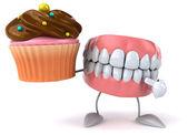 Fun teeth with cupcake — Stock Photo