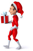 Fun young Santa Claus with gift — Stockfoto