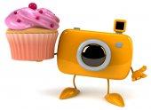 Leuke camera met cupcake — Stockfoto